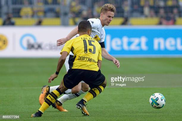 Jeremy Toljan of Dortmund and Nico Elvedi of Moenchengladbach battle for the ball during the Bundesliga match between Borussia Dortmund and Borussia...