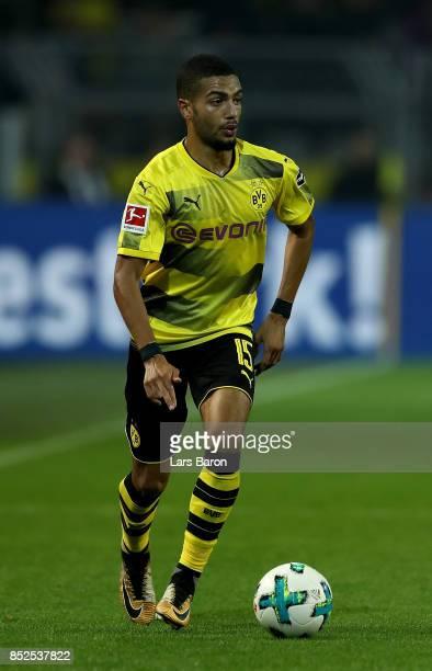 Jeremy Toljan of Dortmund runs with the ball during the Bundesliga match between Borussia Dortmund and Borussia Moenchengladbach at Signal Iduna Park...