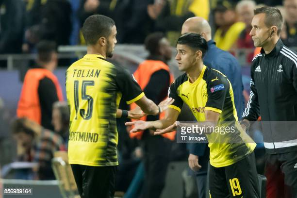 Jeremy Toljan of Dortmund shakes hands with Mahmound Dahoud of Dortmund during the UEFA Champions League group H match between Borussia Dortmund and...