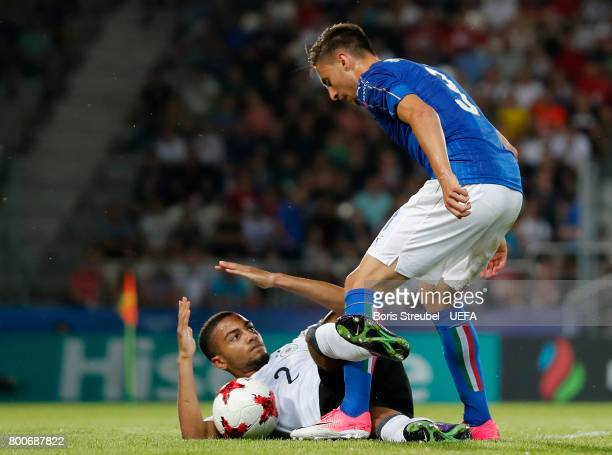 Jeremy Toljan of Germany and Antonio Barreca of Italy fight for the ball during the UEFA European Under21 Championship Group C match between Italy...