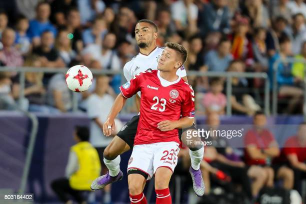 Jeremy Toljan of Germany and Mikkel Duelund of Denmark battle for the ball during the UEFA European Under21 Championship Group C match between...