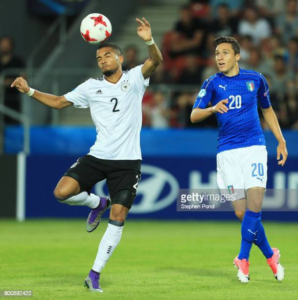 Jeremy Toljan of Germany controls the ball from Federico Chiesa of Italy during the 2017 UEFA European Under21 Championship Group C match between...