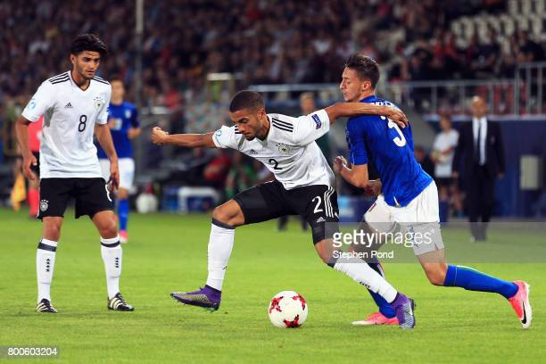 Jeremy Toljan of Germany is fouled by Antonio Barreca of Italy during the 2017 UEFA European Under21 Championship Group C match between Italy and...