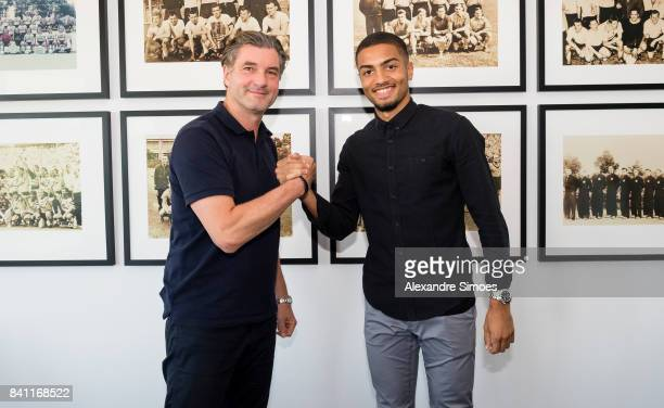 Jeremy Toljan signs a new contract with Borussia Dortmund with Michael Zorc on August 30 2017 in Dortmund Germany