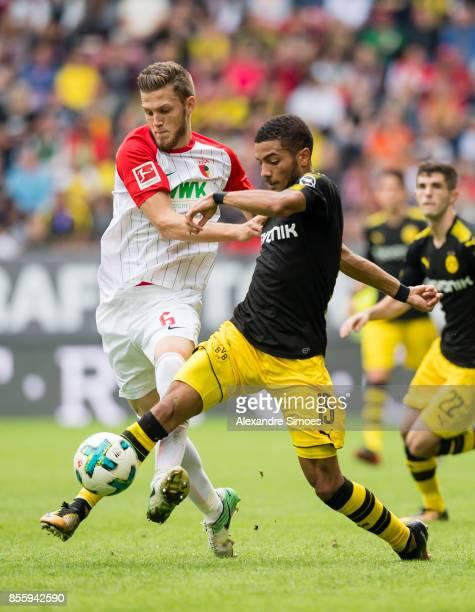 Jeremy Toljanodo and Jeffrey Gouweleeuw of FC Augsburg during the Bundesliga match between FC Augsburg and Borussia Dortmund at WWKArena on September...
