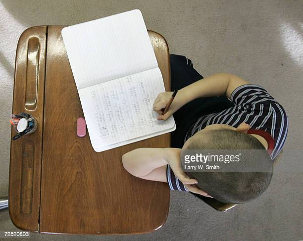 Jeremy Torres a third grade student works on a paper at the Hill Public School January 25 2005 near Bayard Nebraska The eight student one room school...