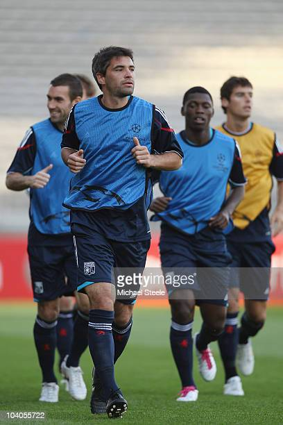 Jeremy Toulalan attends the Olympic Lyon Training session ahead of their Group B UEFA Champions League first phase match against Schalke 04 at Stade...