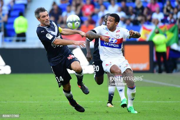 Jeremy Toulalan of Bordeaux and Memphis Depay of Lyon during the Ligue 1 match between Olympique Lyonnais and FC Girondins de Bordeaux at Groupama...