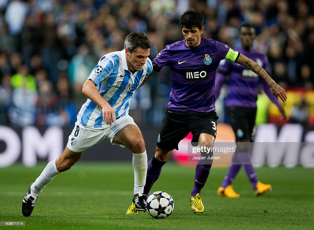 Jeremy Toulalan (L) of Malaga CF duels for the ball with Lucho Gonzalez of FC Porto during the UEFA Champions League Round of 16 second leg match between Malaga CF and FC Porto at La Rosaleda Stadium on March 13, 2013 in Malaga, Spain.