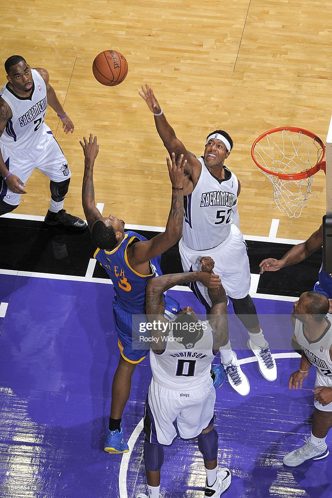 Jeremy Tyler #3 of the Golden State Warriors and James Johnson #52 of the Sacramento Kings go after the rebound on October 17, 2012 at Power Balance Pavilion in Sacramento, California.
