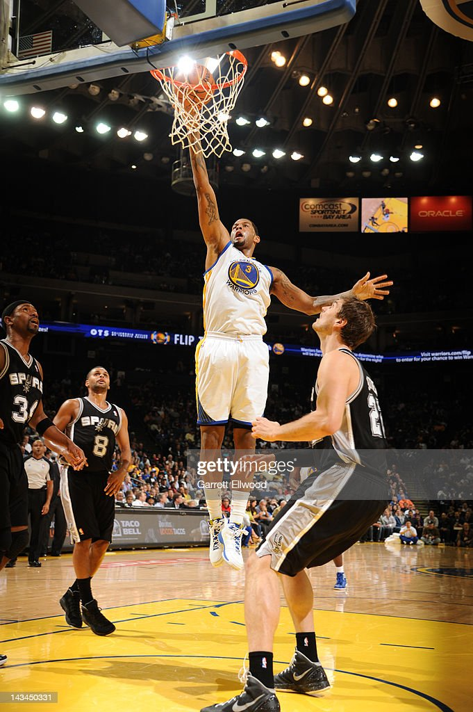 Jeremy Tyler #3 of the Golden State Warriors goes to the basket against Tiago Splitter #22 of the San Antonio Spurs on April 26, 2012 at Oracle Arena in Oakland, California.
