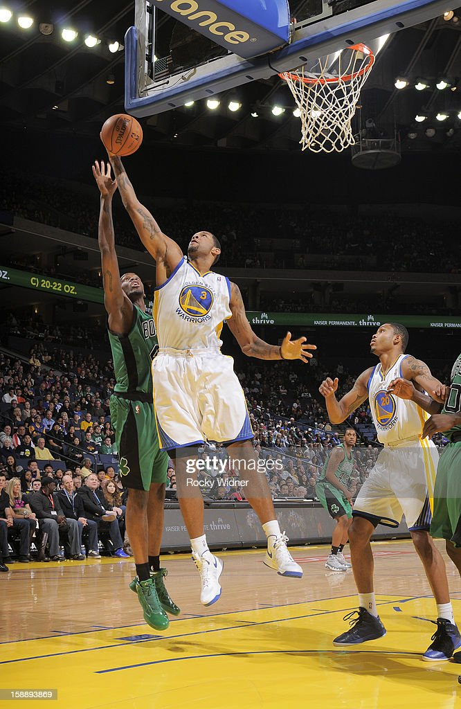 Jeremy Tyler #3 of the Golden State Warriors grabs the rebound against Jarvis Varnado #41 of the Boston Celtics on December 29, 2012 at Oracle Arena in Oakland, California.