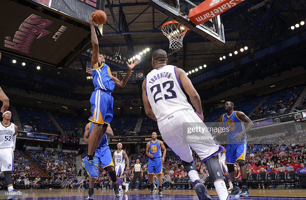 Jeremy Tyler #3 of the Golden State Warriors secures the rebound in a game against the Sacramento Kings on October 17, 2012 at Power Balance Pavilion in Sacramento, California.