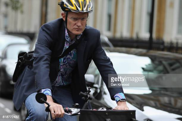 Jeremy Vine leaves BBC Wogan House on his bicycle after presenting his Radio 2 Show on July 19 2017 in London England The BBC has published the pay...