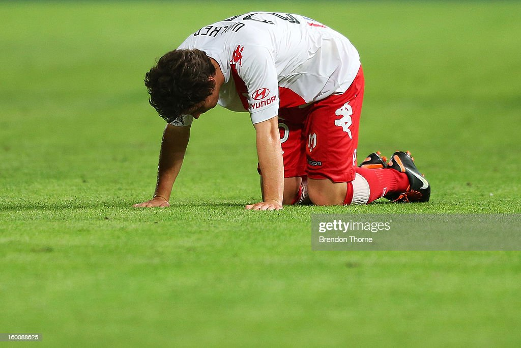 Jeremy Walker of the Heart slumps to the ground at full time following the round 18 A-League match between the Western Sydney Wanderers and the Melbourne Heart at Parramatta Stadium on January 26, 2013 in Sydney, Australia.