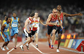Jeremy Wariner of the US runs with the baton towards the finishline to win the men's 4x400m relay final at the 'Bird's Nest' National Stadium during...