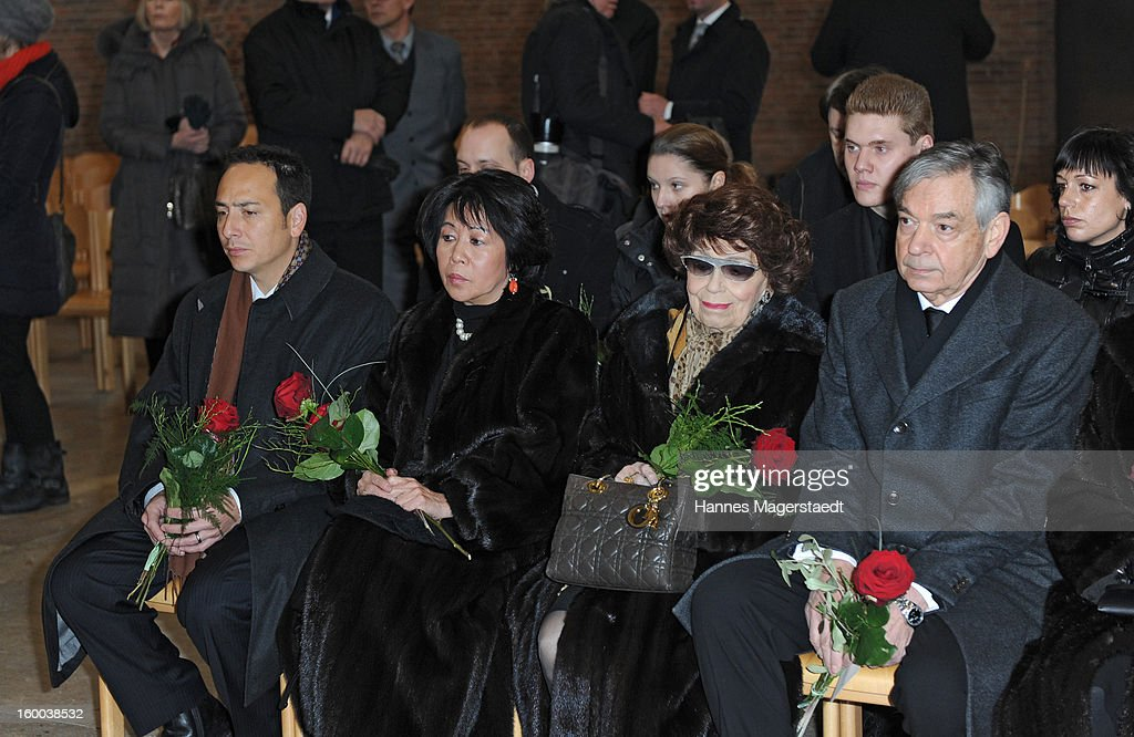 Jeremy Wilson, Soo Leng-Kuchenreuther, Ingeborg Kuchenreuther (mother of Steffen Kuchenreuther) and Thomas Kuchenreuther (Brother of Steffen Kuchenreuther) attend the memorial service for Steffen Kuchenreuther at the Waldfriedhof on January 25, 2013 in Munich, Germany.