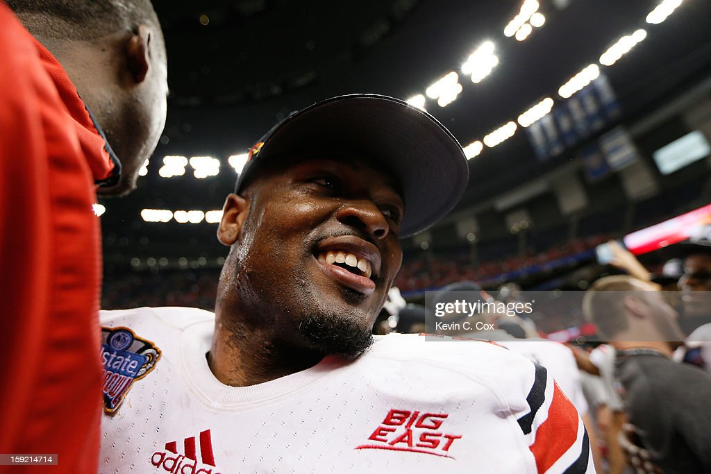 Jeremy Wright #28 of the Louisville Cardinals celebrates after their 33 to 23 win over the Florida Gators in the Allstate Sugar Bowl at Mercedes-Benz Superdome on January 2, 2013 in New Orleans, Louisiana.