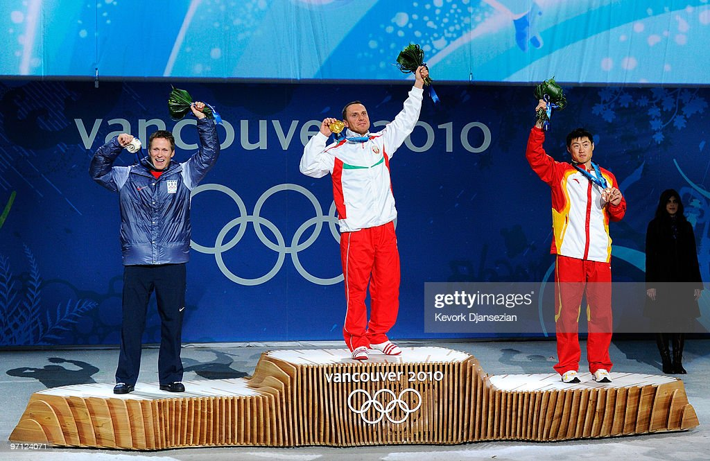 <a gi-track='captionPersonalityLinkClicked' href=/galleries/search?phrase=Jeret+Peterson&family=editorial&specificpeople=814930 ng-click='$event.stopPropagation()'>Jeret Peterson</a> of the United States celebrates winning the silver medal, <a gi-track='captionPersonalityLinkClicked' href=/galleries/search?phrase=Alexei+Grishin&family=editorial&specificpeople=879803 ng-click='$event.stopPropagation()'>Alexei Grishin</a> of Belarus gold and <a gi-track='captionPersonalityLinkClicked' href=/galleries/search?phrase=Liu+Zhongqing&family=editorial&specificpeople=4132720 ng-click='$event.stopPropagation()'>Liu Zhongqing</a> of China bronze during the medal ceremony for the men�s freestyle skiing aerials on day 15 of the Vancouver 2010 Winter Olympics at BC Place on February 26, 2010 in Vancouver, Canada.