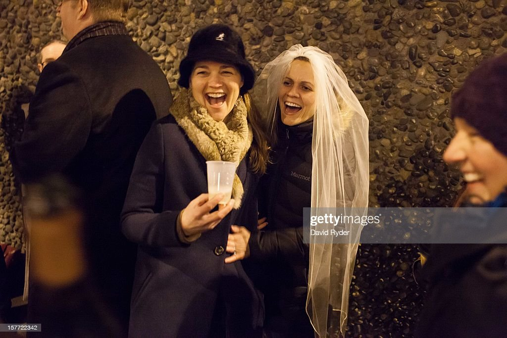 Jeri and Amy Andrews laugh as they wait in line outside of the King County Recorder's Office on December 5, 2012 in Seattle, Washington. The office is due to open at 12:01 AM PST the following morning to begin issuing marriage licenses to same-sex couples for the first time, after Washington voters chose to legalize same-sex marriage in November's election.