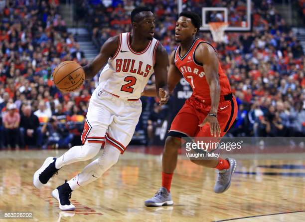 Jerian Grant of the Chicago Bulls dribbles the ball as Kyle Lowry of the Toronto Raptors defends during the first half of an NBA game at Air Canada...