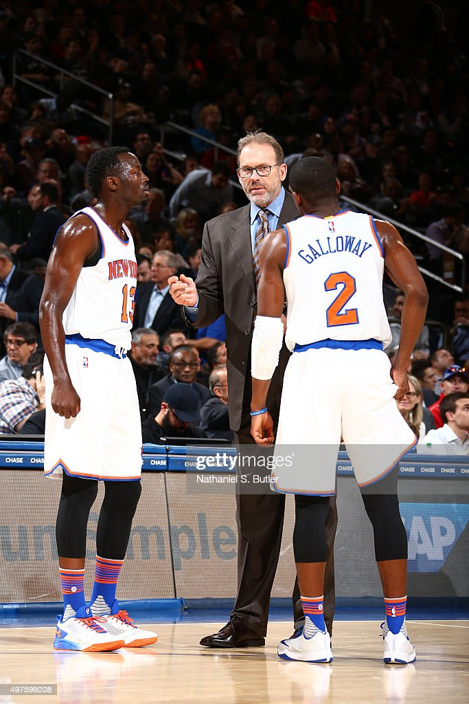 Jerian Grant of the New York Knicks and Langston Galloway of the New York Knicks talk with coach Kurt Rambis during the game against the San Antonio...