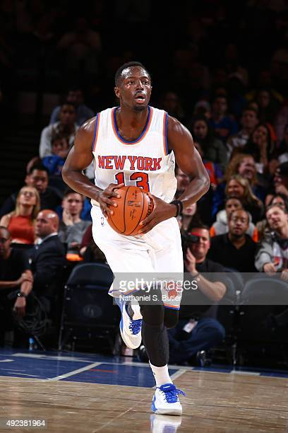 Jerian Grant of the New York Knicks brings the ball up court against the Philadelphia 76ers on October 12 2015 at Madison Square Garden in New York...