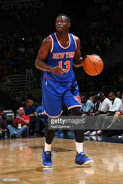 Jerian Grant of the New York Knicks dribbles the ball against the Washington Wizards during a preseason game on October 9 2015 at Verizon Center in...