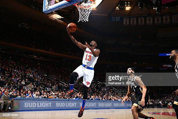 Jerian Grant of the New York Knicks goes to the basket against the Toronto Raptors on April 10 2016 at Madison Square Garden in New York City NOTE TO...