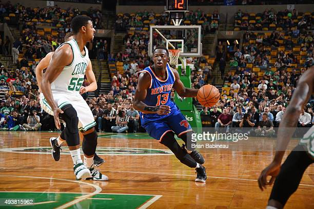 Jerian Grant of the New York Knicks handles the ball against the Boston Celtics during a preseason game on October 22 2015 at the TD Garden in Boston...