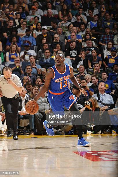 Jerian Grant of the New York Knicks handles the ball against the Golden State Warriors on March 16 2016 at ORACLE Arena in Oakland California NOTE TO...