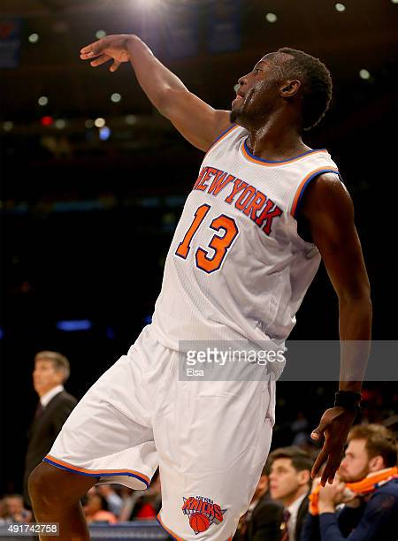 Jerian Grant of the New York Knicks watches his shot in the second half during a preseason exhibition game against Paschoalotto Bauru at Madison...
