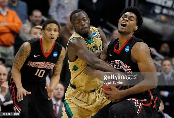 Jerian Grant of the Notre Dame Fighting Irish and Quincy Ford of the Northeastern Huskies vie for posession during the second round of the 2015 NCAA...