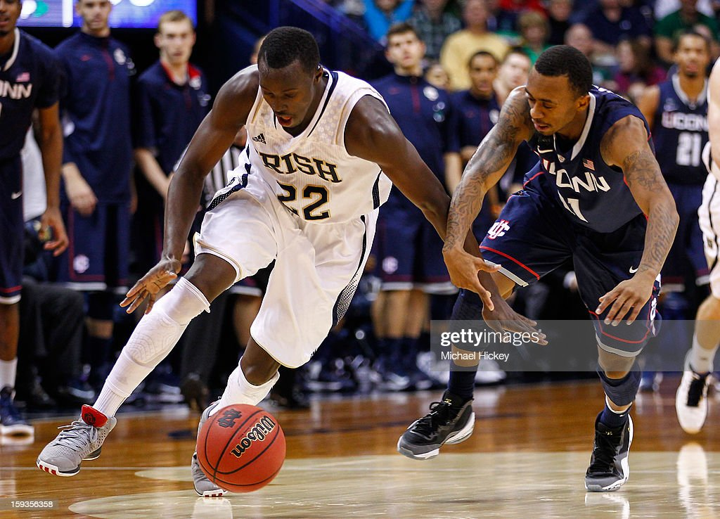 Jerian Grant #22 of the Notre Dame Fighting Irish and Ryan Boatright #11 of the Connecticut Huskies chase down a loose ball at Purcel Pavilion on January 12, 2013 in South Bend, Indiana. Connecticut defeated Notre Dame 65-58.
