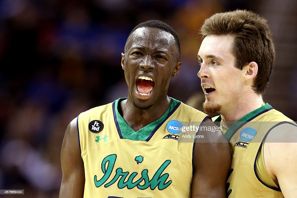 <a gi-track='captionPersonalityLinkClicked' href=/galleries/search?phrase=Jerian+Grant&family=editorial&specificpeople=6681559 ng-click='$event.stopPropagation()'>Jerian Grant</a> #22 of the Notre Dame Fighting Irish celebrates with <a gi-track='captionPersonalityLinkClicked' href=/galleries/search?phrase=Pat+Connaughton&family=editorial&specificpeople=8664629 ng-click='$event.stopPropagation()'>Pat Connaughton</a> #24 after a play in the second half against the Wichita State Shockers during the Midwest Regional semifinal of the 2015 NCAA Men's Basketball Tournament at Quicken Loans Arena on March 26, 2015 in Cleveland, Ohio.