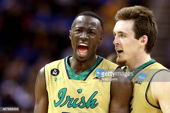 Jerian Grant of the Notre Dame Fighting Irish celebrates with Pat Connaughton after a play in the second half against the Wichita State Shockers...