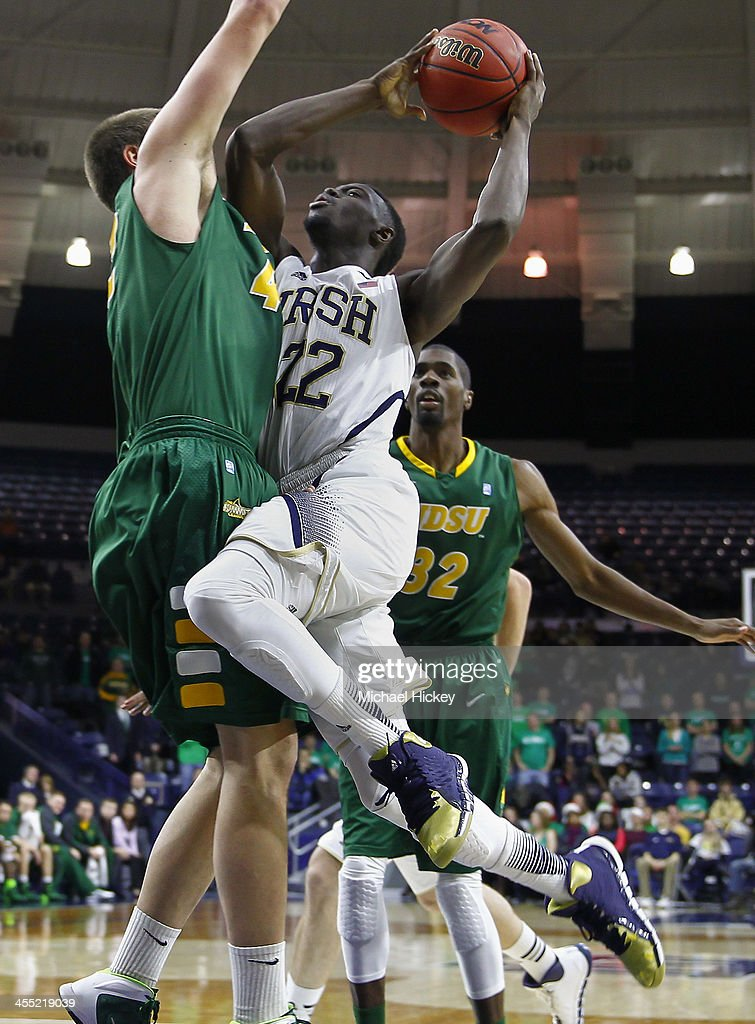 Jerian Grant #22 of the Notre Dame Fighting Irish drives to the basket against Marshall Bjorklund #42 of the North Dakota State Bison at Purcel Pavilion on December 11, 2013 in South Bend, Indiana.