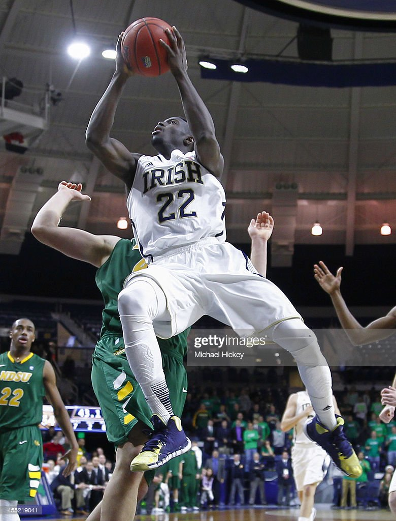 Jerian Grant #22 of the Notre Dame Fighting Irish drives to the basket against the North Dakota State Bison at Purcel Pavilion on December 11, 2013 in South Bend, Indiana. North Dakota State defeated Notre Dame 73-69.