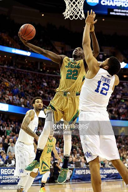 Jerian Grant of the Notre Dame Fighting Irish drives to the basket against KarlAnthony Towns of the Kentucky Wildcats in the second half during the...