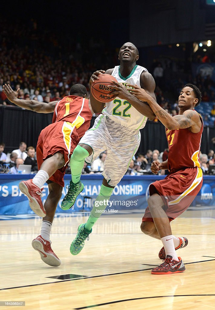 Jerian Grant #22 of the Notre Dame Fighting Irish drives with the ball against Bubu Palo #1 and Will Clyburn #21 of the Iowa State Cyclones in the second half during the second round of the 2013 NCAA Men's Basketball Tournament at UD Arena on March 22, 2013 in Dayton, Ohio.