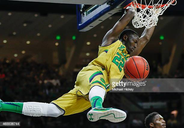 Jerian Grant of the Notre Dame Fighting Irish dunks the ball against the Clemson Tigers at Purcell Pavilion on March 7 2015 in South Bend Indiana...