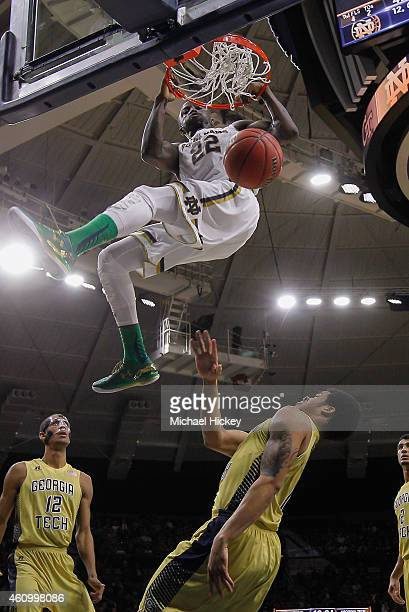 Jerian Grant of the Notre Dame Fighting Irish dunks the ball over Tadric Jackson of the Georgia Tech Yellow Jackets at Purcell Pavilion on January 3...