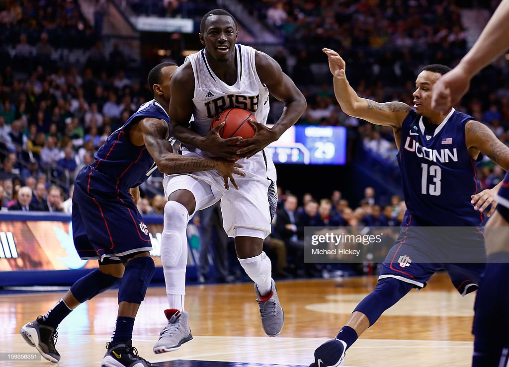 Jerian Grant #22 of the Notre Dame Fighting Irish makes a move to the basket as Shabazz Napier #13 of the Connecticut Huskies defends at Purcel Pavilion on January 12, 2013 in South Bend, Indiana. Connecticut defeated Notre Dame 65-58.