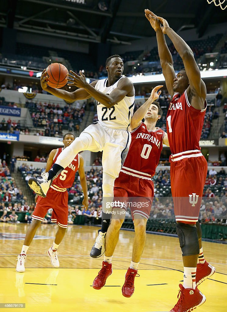 Jerian Grant #22 of the Notre dame Fighting Irish passes the ball while defended by Noah Vonleh #1 of the Indiana Hoosiers during the 2013 Crossroads Classic at Bankers Life Fieldhouse on December 14, 2013 in Indianapolis, Indiana.