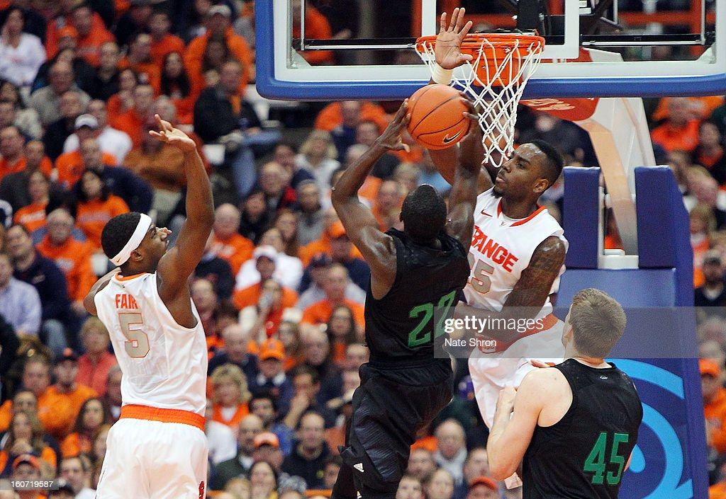 Jerian Grant #22 of the Notre Dame Fighting Irish puts the ball up to the basket with teamate Tom Knight #45 against Rakeem Christmas #25 and C.J. Fair #45 of the Syracuse Orange during the game at the Carrier Dome on February 4, 2013 in Syracuse, New York.