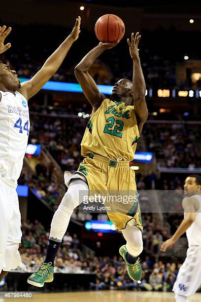 Jerian Grant of the Notre Dame Fighting Irish shoots against Dakari Johnson of the Kentucky Wildcats in the second half during the Midwest Regional...