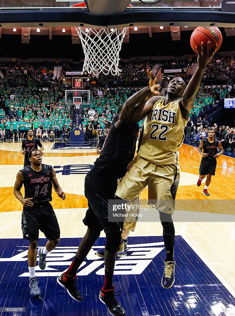 Jerian Grant #22 of the Notre Dame Fighting Irish shoots against the Cincinnati Bearcats at Purcel Pavilion on February 24, 2013 in South Bend, Indiana. Notre Dame defeated Cincinnati 62-41.