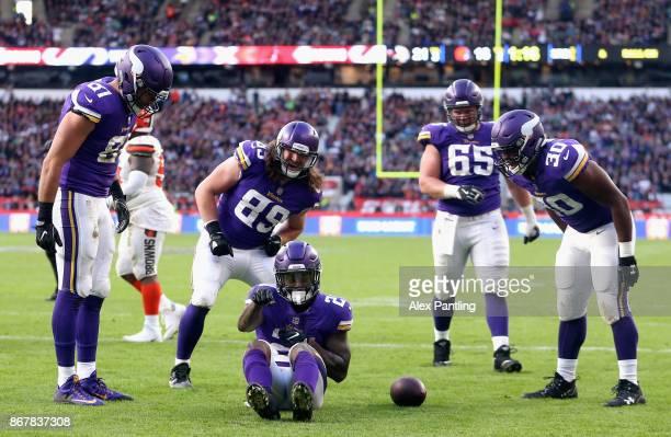 Jerick McKinnon of Minisota Vikings celebrates with team mates after scoring a touchdown during the NFL International Series match between Minnesota...