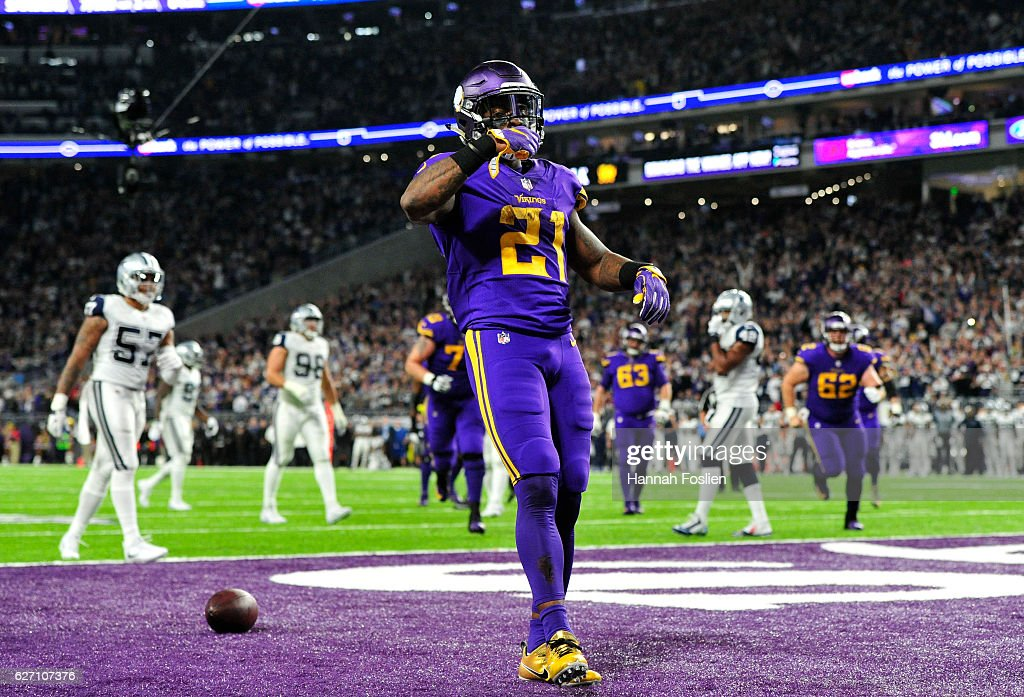 Jerick McKinnon #21 of the Minnesota Vikings celebrates a three-yard touchdown reception in the fourth quarter of the game against the Dallas Cowboys on December 1, 2016 at US Bank Stadium in Minneapolis, Minnesota.