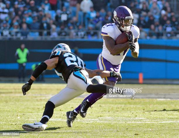 Jerick McKinnon of the Minnesota Vikings cuts back against Kurt Coleman of the Carolina Panthers during their game at Bank of America Stadium on...